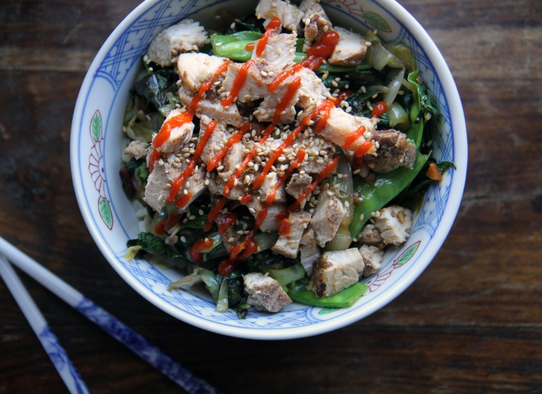 chicken rice bowl with sriracha and vegetables